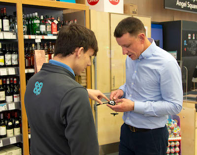 Nick Crofts, Council President speaking to a member of store staff