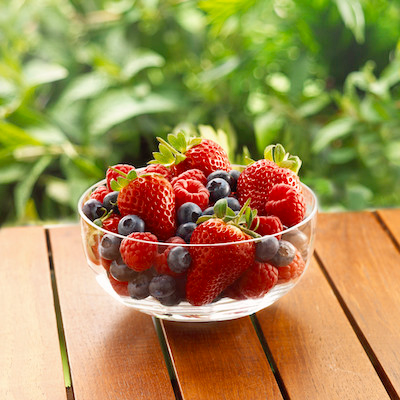 Berries in bowl on table