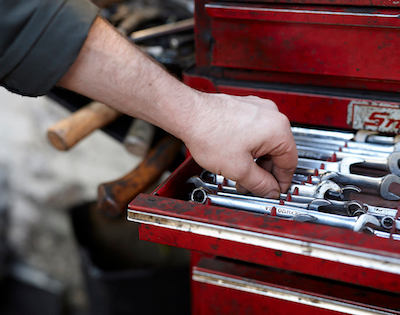 Mechanic hand grabbing tools