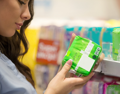 Woman in store looking at sanitary protection