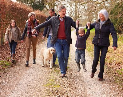 Family walking along country lane