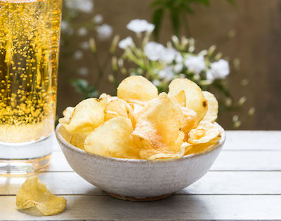 Bowl of crisps on a table